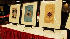 Gorgeous prints in the MinaLima booth at LeakyCon filled with graphic design from the Harry Potter movies! Full blog post: http://karenkavett.com/blog/878/minalima-at-leakycon.php