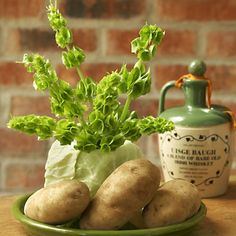 cute idea for St Patrick's Day decorations using a cabbage and potatoes