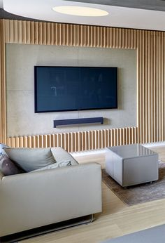 Interior Design Idea – A Section Of This Wood Covered Wall Was Left Empty For The TV
