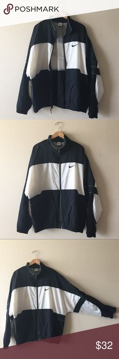 """NIKE vintage 90s black & white windbreaker Do you miss the 90s, but not the awful fashion choices that you've made? This windbreaker is your answer then! Made with the retro 90s colorblock styling of its time, its neutral colors make this windbreaker a stylish retro classic. This windbreaker has two small snags as pictured, but is still in great wearable quality.  Bust: 27.5"""" Length: 27.5"""" Nike Jackets & Coats Windbreakers"""