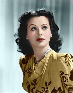 Hedy Lamarr looking absolutely gorgeous in dusty mustard yellow.