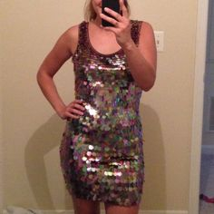 🎉This is THE Dress🎉 Front shimmer sequin decals. So elegant; the back as you see in pics is spandex maroon color. Bought in a Ellsys Boutique in Puerto Rico. Never worn. It is a small but will fit a medium easily. Would be amazing for Any celebration!🎉 Dresses