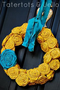 Beachy Yellow and Turquoise Rosette Wreath    http://tatertotsandjello.com/2012/07/canvas-rosette-wreath-tutorial.html