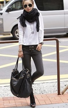 Black skinnies, white long sleeve t-shirt, belt, scarf, boots