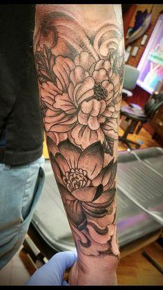 Flowers tattoo by Jeff at Liquid Swordz. Ypsilanti, Michigan