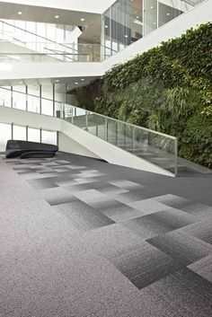 Fuse is a striking transition carpet tile that adds movement to the floor by effortlessly flowing between two contrasting yet complimentary colour schemes to help zone and divide a space.