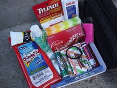 Mom's Survival Kit   {for the car}     Contents...        chapstick      hand sanitizer      kleenex      band aids      tylenol      hand lotion      wet wipes      hair elastic      post-its & pen      throat lozenges      mints      nail clippers      chocolate