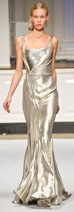 Oscar De La Renta 12/13.  I accept that there are only about six people in the world who can get away with wearing something clingy, shiny, and silver... But it's still gorgeous.