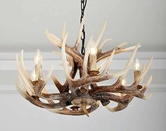 The EFFORTINC 6 Lights Resin Deer Horn Antler Chandeliers are some of the highest quality faux antler chandelier's that you can find on the market today. The replication process which has … Deer Antler Chandelier, Deer Lamp, Antler Lights, Luxury Chandelier, Antique Chandelier, Modern Chandelier, Deer Horns Decor, Antlers, Antler Light Fixtures