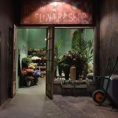 """TSUM DEPARTMENT STORE, Moscow, Russia, """"The Manhattan Flower Shop"""", pinned by Ton van der Veer Store Displays, Window Displays, Apple Mint, Front Gates, Monstera Deliciosa, Store Windows, Shop Front Design, Facade Design, Flower Shops"""