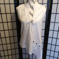 Blanc du Nil Cream Top This is such a fun & comfy top with an asymmetrical look, low neck line  & metal buttons. Wear it over bathing suits or with shorts, pants or skirts. Blanc du Nil Tops Tunics