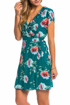 Crossover panels form the ruffled neckline on this breezy MINKPINK dress. Hidden back zip. Cap sleeves. Lined. Hand wash cold  Floral Dress by MinkPink. Clothing - Dresses - Wrap Dress Orange County California