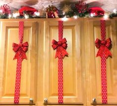 Tape red polka dot ribbon onto your kitchen cupboards and hot glue glittery red bows on top! Simple, really pretty, and you can reuse the supplies year after year for Christmas!