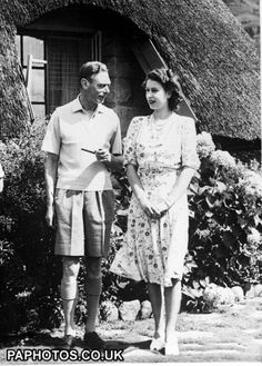 An informal picture of King George VI relaxing with his daughter Princess Elizabeth during a visit to Natal National Park in South Africa.