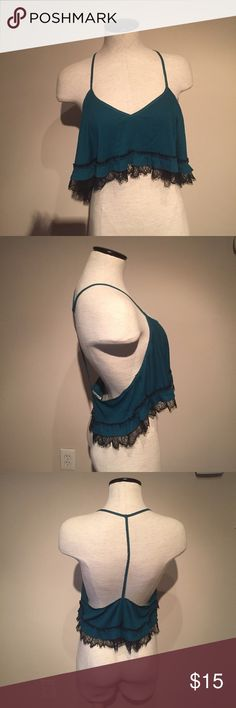 Free people teal w black lace detail crop top NWOT Free people teal w black lace detail crop top. Loose fit. Size medium. Armpit to armpit is 17 inches and length is 15 inches. Free People Tops Crop Tops