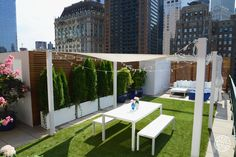 Our Roof Deck Design Roundup - This deck really knocks it out of the park. With several lounge areas, a dining area and great views of the Hudson River, it's a real extension of the Tribeca home. Astroturf upgrades the space and keeps it feeling grounded (pun intended). - @Homepolish San Francisco