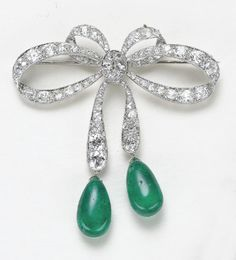 PHILLIPS : NY060109, , A Diamond and Emerald Bow Brooch