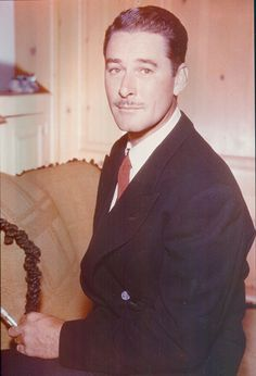 errol flynn in color | He is every bit the aristocratic gentleman that he wanted to be.