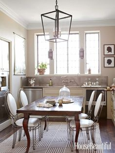 A pretty table and chairs makes a great alternative to an island, while a single large-scale lantern or chandelier hanging above it will punctuate the room. Design: Bates Corkern Studio