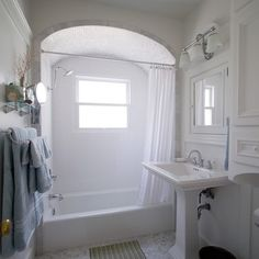 A dingy bath gets a bright and airy makeover with a dramatic arch from this ambitious reader. | thisoldhouse.com/yourTOH