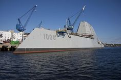 The US Navy has christened the first of three cutting-edge Zumwalt-class destroyers. But the next two may have weaponry straight out of science fiction.