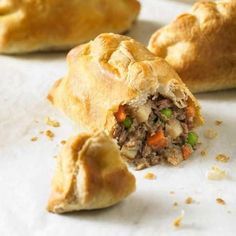 Cornish Pasty,  Chunks of steak and minced beef with potato, onion, carrots and peas, lightly seasoned and enclosed in a puff pastry case