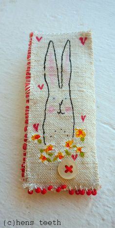 Hens Teeth bunny Brooch///Love how she paints on the little flowers