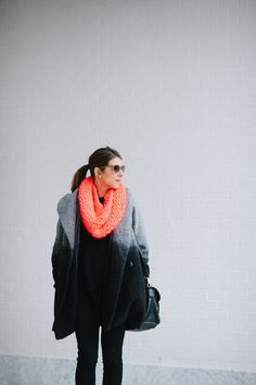 This ombre winter coat is too cute! We love the bright pop of color when paired with a colorful scarf.