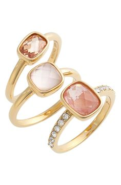 Soft crystals in shades of pink make these gold rings sparkle and shine for a feminine chic look.