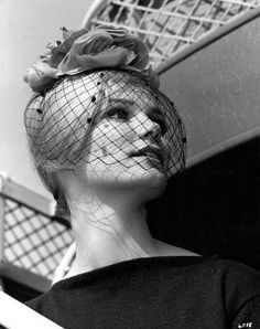 Beautiful cocktail hat with a properly made (blocked) birdcage veil. These days we get to see too many haphazardly thrown veils, it's a joy to see this. I also love the chenille dot details.