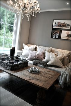Love the chandelier in the living room. Griege colour scheme