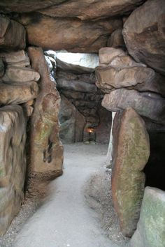 West Kennet Long Barrow.  One of the largest and most impressive Neolithic graves in Britain, West Kennet long barrow was built in around 3400 BCE and used for at least 1,000 years. View down the central passageway to the west chamber, the largest of the five burial chambers.   Distance from Shaftesbury to Avebury is 42 miles