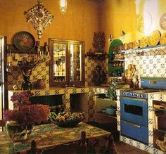 No cabinets, really..  Tile everywhere, under-counter shelving and lots of hanging for utensils, cups, plates