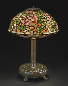 """** Tiffany Studios New York """"Apple Blossom"""" leaded glass and patinated bronze table lamp."""