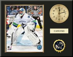 One 8 x 10 inch Vancouver Canucks photo of Roberto Luongo inserted in a gold slide-in frame and mounted on a 12 x 15 inch solid black finish plaque.  Also features a 3-inch Arabian gold-faced clock, a customizable nameplate* and a 2-inch hockey medallion with a gold base. $59.99  @ ArtandMore.com