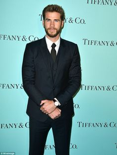Looking good! Liam Hemsworth, 26, cut a dapper figure in a smart black suit and tie at the opening of Tiffany And Co.'s new Beverley Hills store on Thursday
