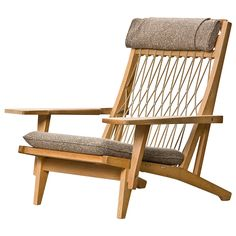 Hans Wegner Lounge Chair is part of Wegner lounge chair - For Sale on Danish Modern lounge chair designed by Hans Wegner for Johannes Hansen with a harmonious mix of different materials such as oak wood, knotted naval rope