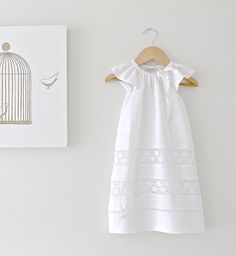 This is a beautiful long length baptism gown with angel sleeves in soft white pure linen, 3 white cotton lace inserts and finished with a delicate