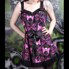 Hell Bunny Skull Dress Vintage, retro, goth, punk, Hot Topic or Iron Fist looking dress. It is new, though does not have the tags on it. The ribbons on the side are attached, and can be tied in front or behind the back. Hell Bunny Dresses