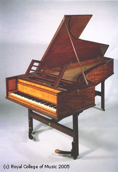 Piano made by John Broadwood & Sons, dated 1799. Note the two pedals jutting out of the two front legs.  This almost looks like a harpsichord!