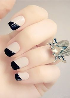 Any girl will love this chic and modern twist on the classic French manicure.  Photo via Pshiiit