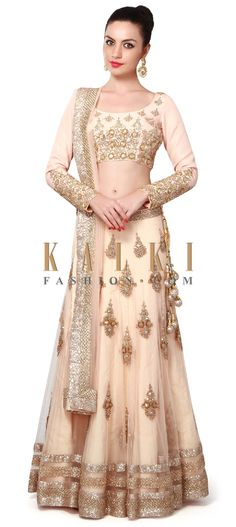 Buy Online from the link below. We ship worldwide (Free Shipping over US$100). Product SKU - 300100. Product Price - $1,269.00. Product link - http://www.kalkifashion.com/light-peach-lehenga-adorn-in-embroidered-butti-only-on-kalki.html
