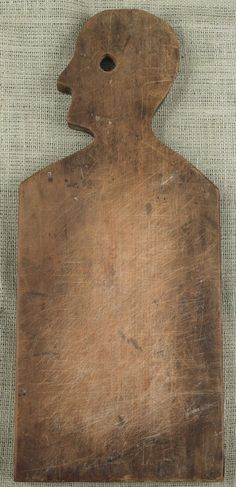 """Pine cutting board in the shape of a man, 19th c., 21"""" H"""