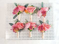 pink boutonnieres, photo by Ashley Goodwin http://ruffledblog.com/kate-spade-inspired-wedding-in-hawaii #grooms #flowers