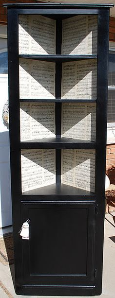 corner cabinet redo-love the sheet music inside.