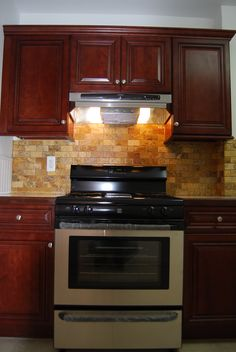 Maolis Kitchen After. Stone Backsplash Cherry Cabinets, Tile Floors