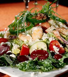 Greek Potato Salad - appears to have kalamata olives, beets, tomatoes, cucumber, feta, shrimp and green Pepper - none of which are listed in the recipe.  The recipe is simply for potatoes and simple dressing.