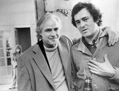 Marlon Brando and director Bernardo Bertolucci on the set of Last Tango in Paris. In the background, Maria Schneider  1972