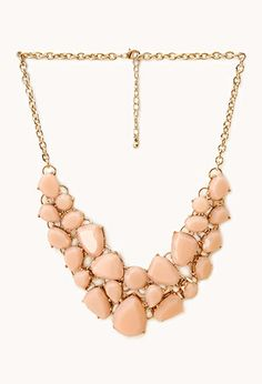 Coral/pink statement/bib necklace (this one is about $13 from Forever 21, but they have them at lots of stores)