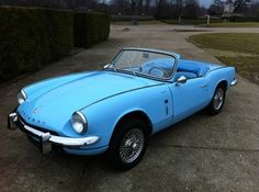 Baby Blue Triumph Spitfire (oh look at that matching interior!!!)